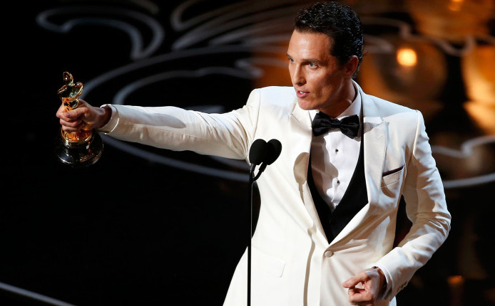 """Matthew McConaughey accepts the Oscar for best actor for his role in """"Dallas Buyers Club"""" at the 86th Academy Awards in Hollywood, California March 2, 2014"""