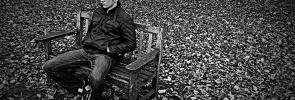 Jamie, sat on a bench.